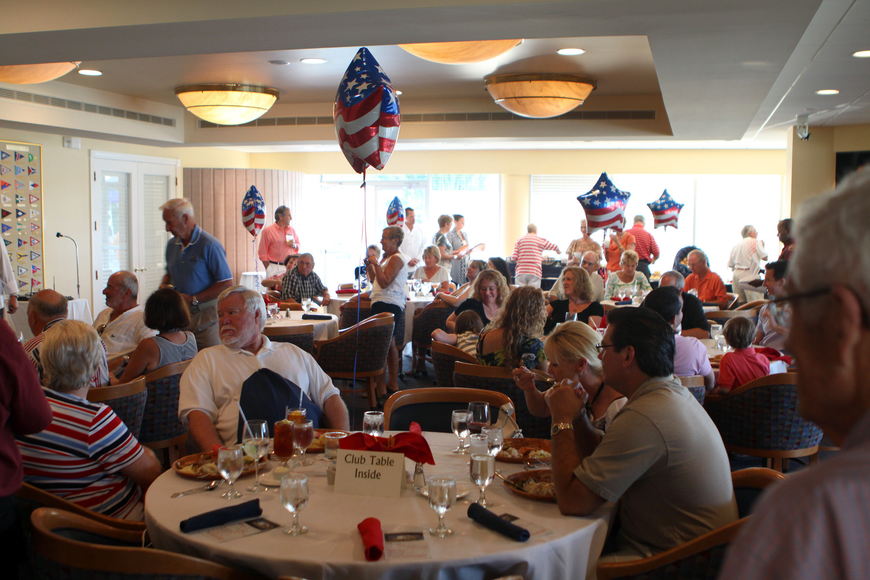 People enjoy their food Saturday, May 28 at Bird Key Yacht Club's Memorial Day party.