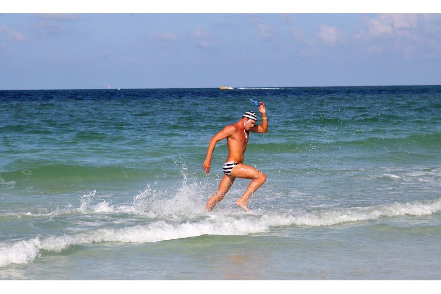 Destin lifeguard Dylan Newbiggin came in first in the men's surf swim event Thursday, July 14 during the 2011 James