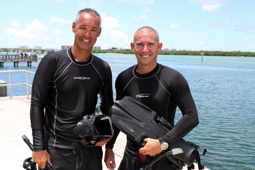 Deputy sheriffs Matt Binkley and Mike Watson pose together after completing the mock marine search and rescue mission Thursday, July 21 at Ken Thompson Park Boat Ramp