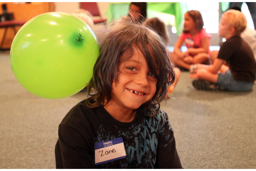 Zane Comingore, 9, got a balloon stuck to his head due to static electricity.