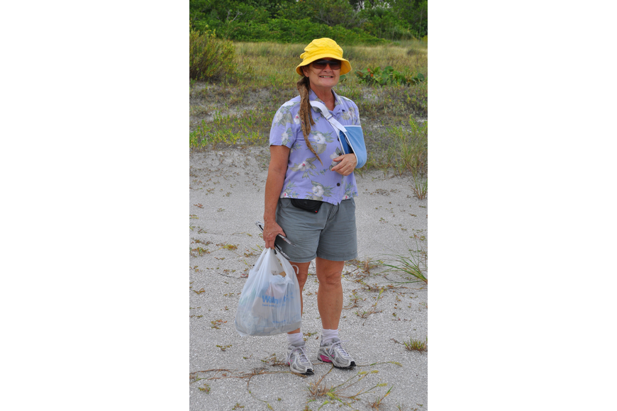 Merrilee Joy helped to clean the beach Thursday, Sept. 8, at Ted Sperling Park.