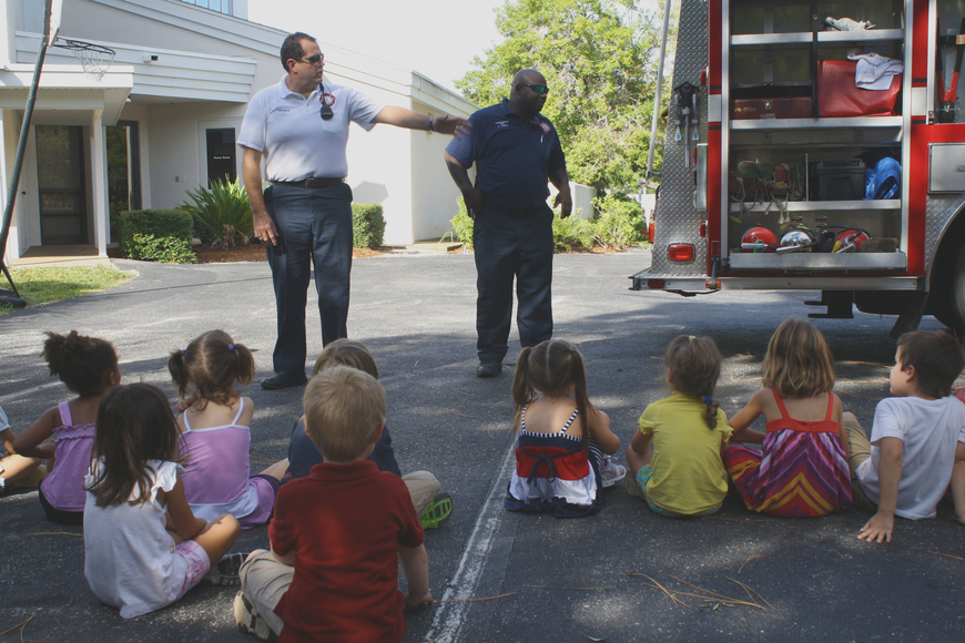 Lieutenant Firefighter Scot Gottschalk and Firefighter Ricky James talk what to do in the event of a fire, and show-off their truck and equipment to 27 eager students at St. Boniface Preschool.