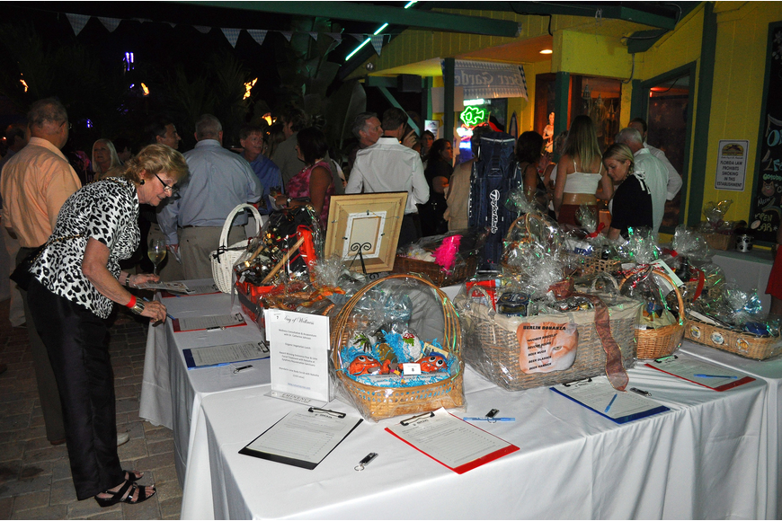 People gathered around the silent auction tables and enjoyed the nice night outside Thurday, Oct. 6 during the 11th annual Okto-Paw-Fest at the Daiqiuri Deck on SIesta Key.