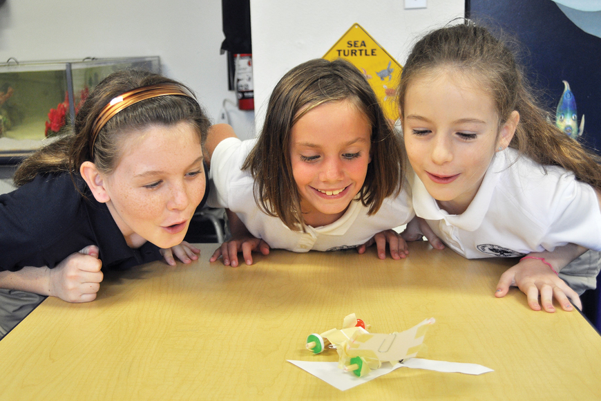 Gillette Bauer, Susan Pacer and Sofia Mascorro sent Life Savers racecars zooming Sept. 8, at The Out-of-Door Academy.