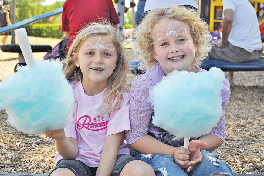 Lindsay Bennett and Gabrielle Bennett enjoyed cotton candy in March at Temple Beth Sholom's Purim Carnival.