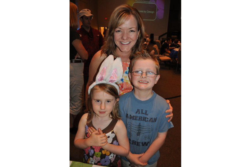 Caryn Patterson and her children, Caleigh and Jonah, checked out the silent auction tables.