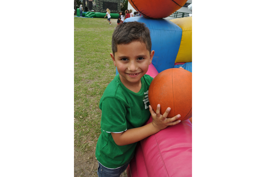 Alan Aguilar, 6, was eager to play basketball.