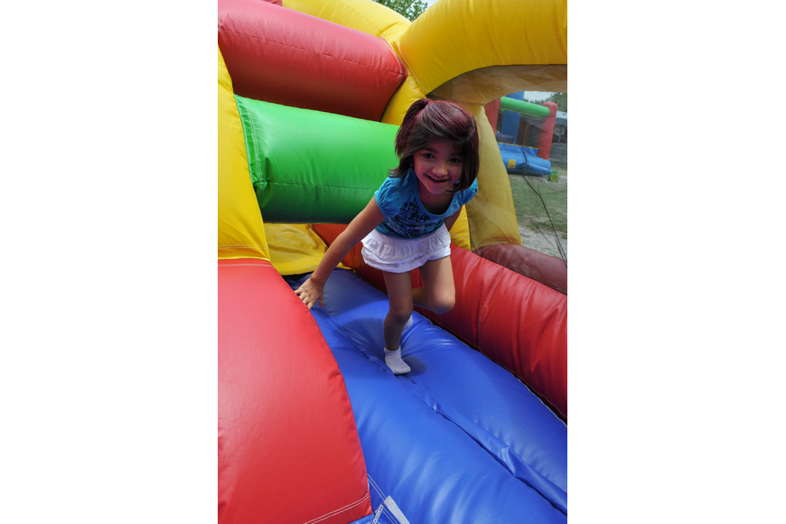 First-grader Gabby Ramirez made her way through the inflatable obstacle course.