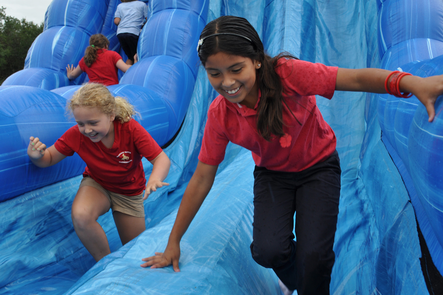 Lusero Acosta, front, and Lizzy Ebury, behind, went on the slide as many times as they could.