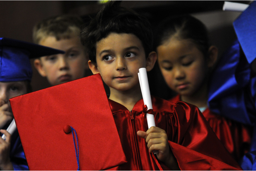 Five-year-old Jake Morales was one of the first graduates to receive his diploma.
