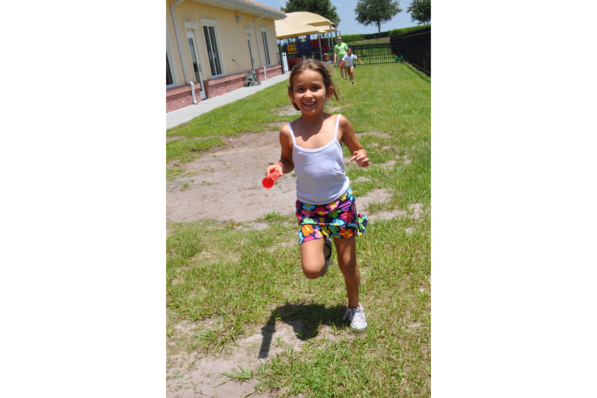 Sophia Aguayo, 7, passed the baton like a professional during the relay event.
