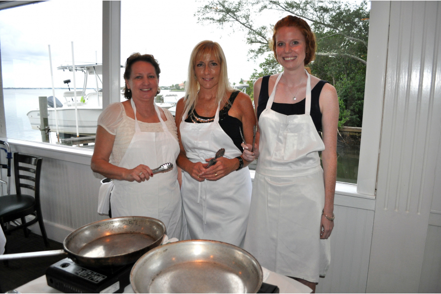 Debra Campion, Tami Richards and Courtney Dougherty prepare to cook during Pattigeorge's Interactive Dinner, Friday, Aug. 17.