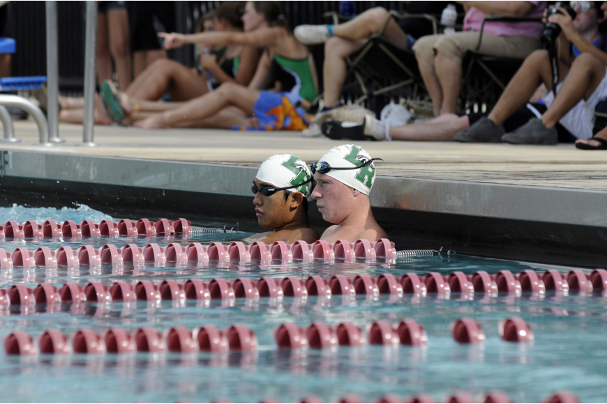 Lakewood Ranch's Jay Cho and Luke Hanner relax in the cool down lanes after completing the 200-yard individual medley.