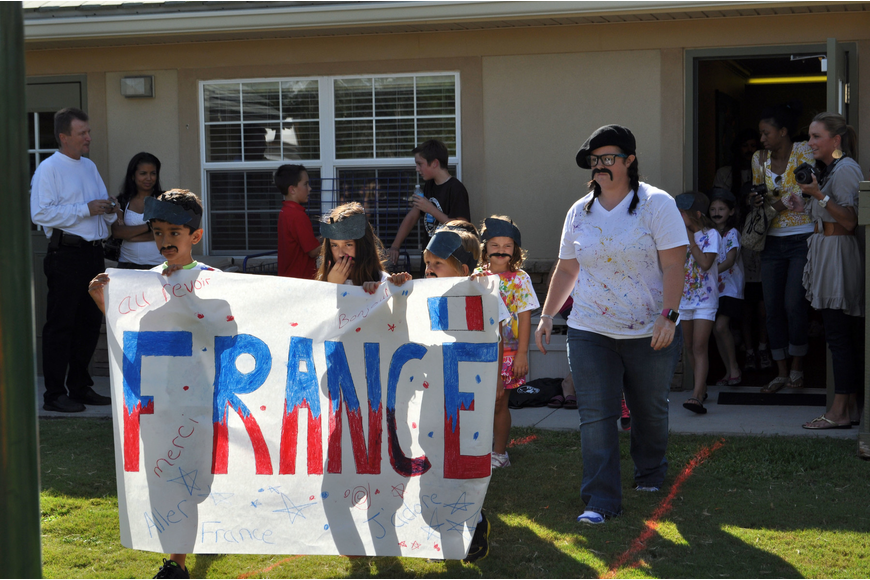Students march in celebration of French culture.