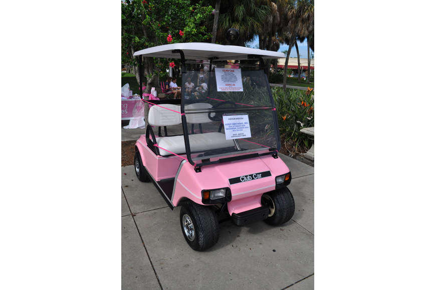 The custom built, pink golf cart was for sale with portions of the sale going to the American Cancer Society.