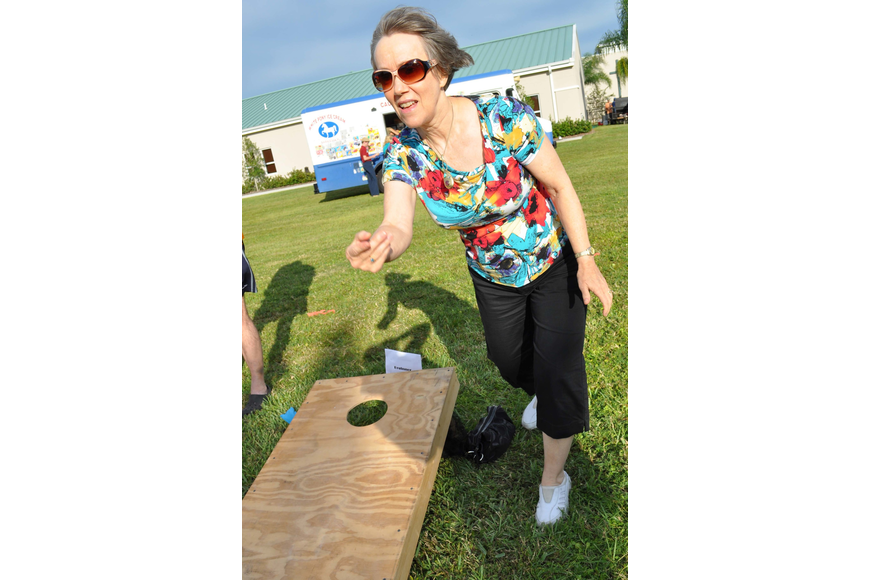 Sharon Bateman played a game of corn hole with her husband, Keith, not pictured.