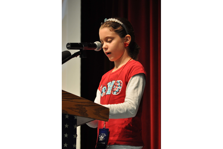 Cadence Bakker, 10, spoke about the history of Veterans Day at at Freedom Elementary's ceremony.