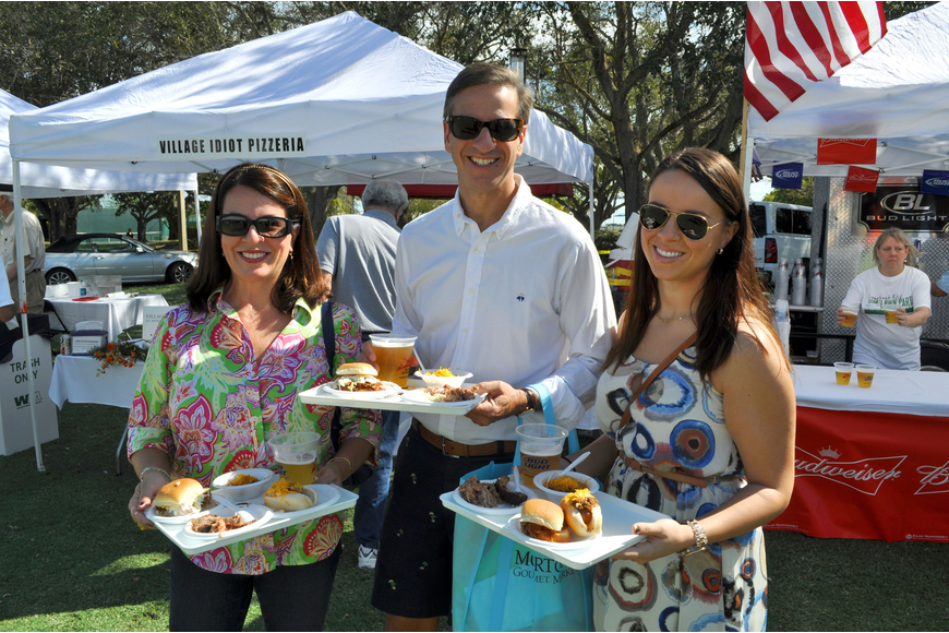Angela, David and Lea Thierman load up their trays with all sorts of delicious food items from a variety of restaurants that took part in the Longboat Key Gourmet Lawn Party.