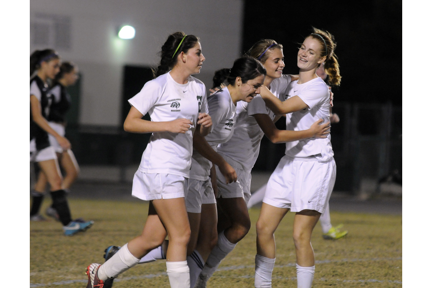 Lakewood Ranch's Angelica Rego, Lindsay Martinez, Tyler Gordon and Megan Hardy celebrate Gordon's goal in the second half.