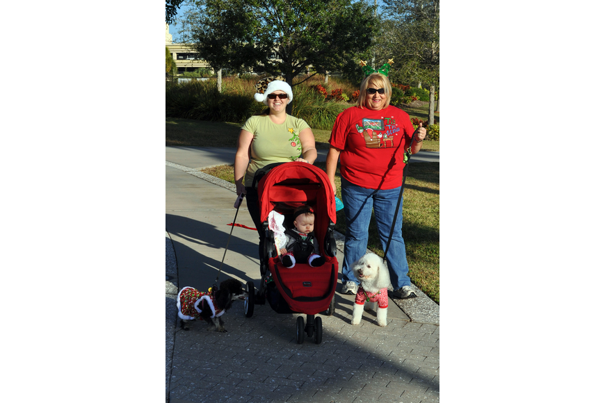 Michala Chipurnoi with her daughter, Gabriella, 9 mos., and Jeanette Schwaed with their dogs Mitzi, 1 ½, and Colt, 6.