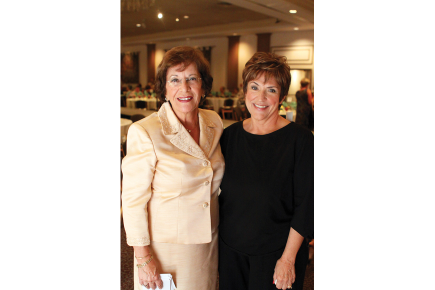 Eleanor Villardi and Linda Piro enjoyed St. Michael the Archangel Women's Guild's annual Fashion Show and Luncheon Feb. 29 at Michael's On East.