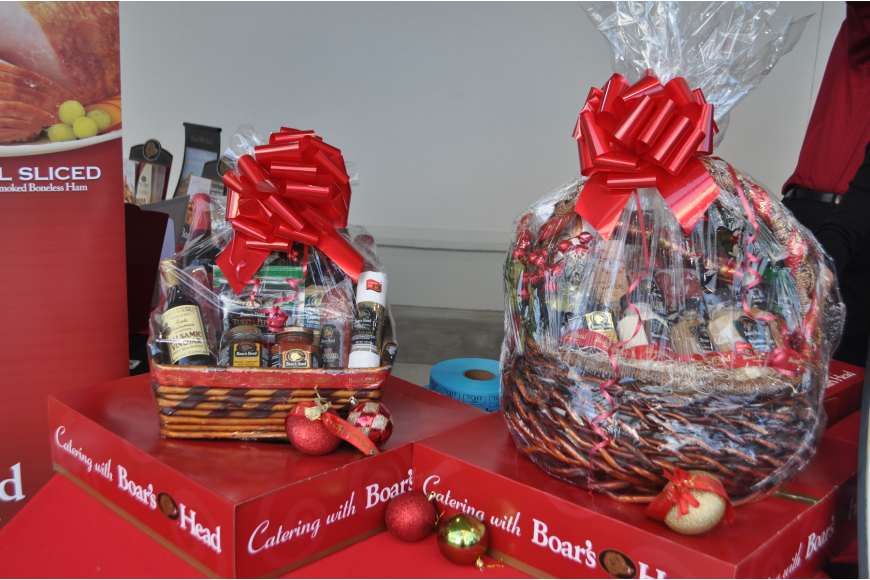 Customers entered a raffle for Boars Head gift baskets outside of the store.