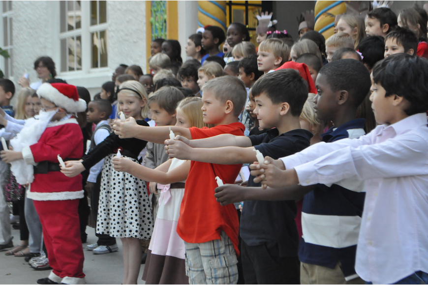 All six first grade classes sing a song in unison.