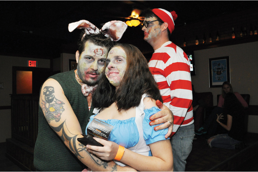 Charles and Danielle Cramblitz and Where's Waldo zombie Greg Werner took part in the annual Gulf Gate Zombie Pub Crawl.