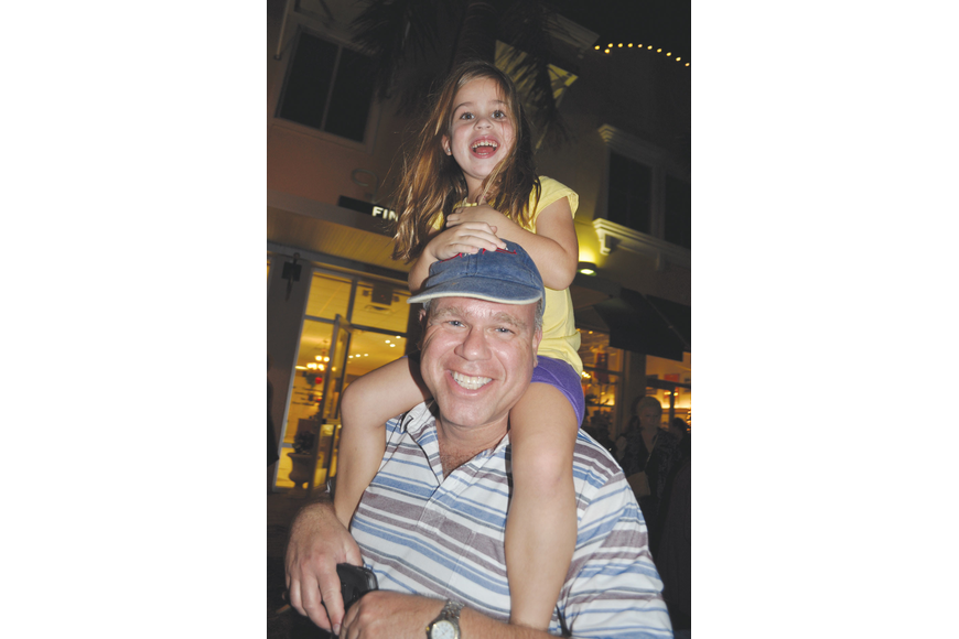 David Korman gives his daughter, Zoe, 5,a ride, during a