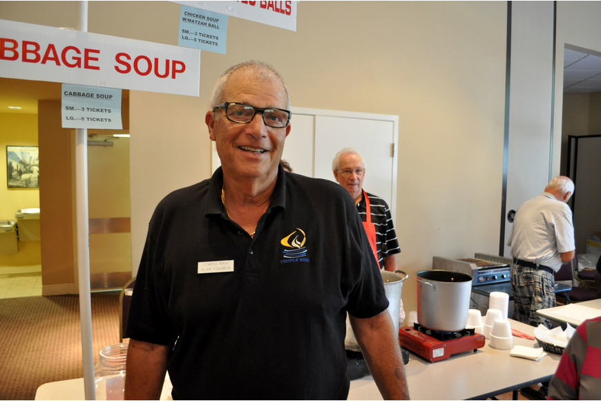 Alan Fishbein stands near the cabbage soup he cooked from his mother's recipe.