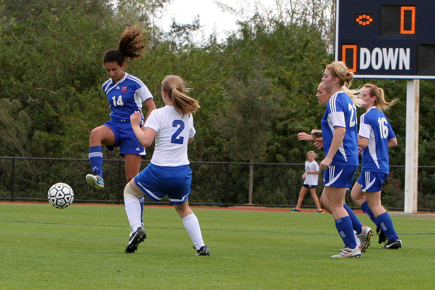 Northside Christian's Danielle Nashed, No. 14, jumps up high to get at the ball while Sarasota Christian's Hannah Youngblood, No. 2, tries to defend and get the ball back.