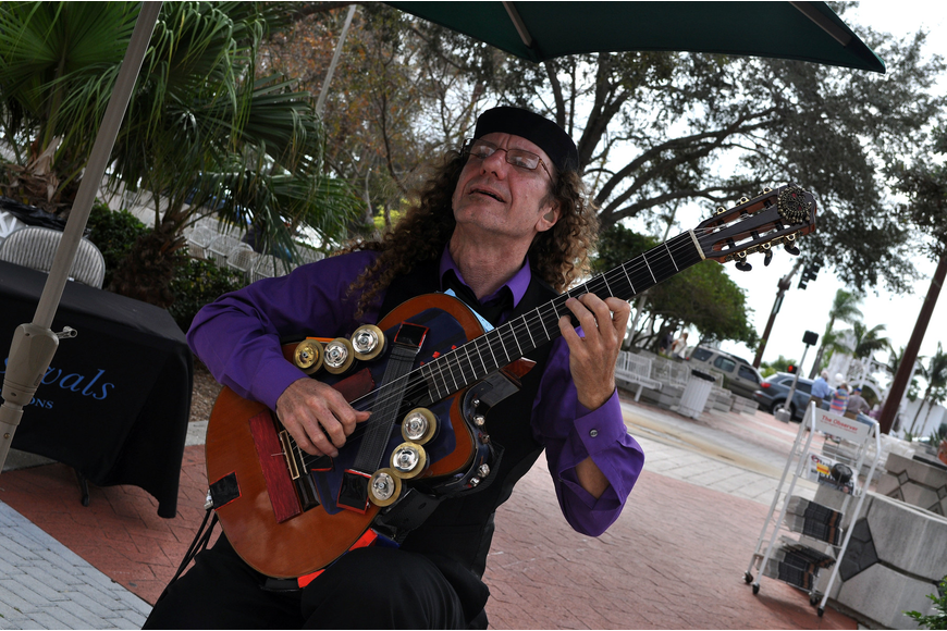 Russell Donnellon plays his guitar on the corner of Main and Gulfstream.