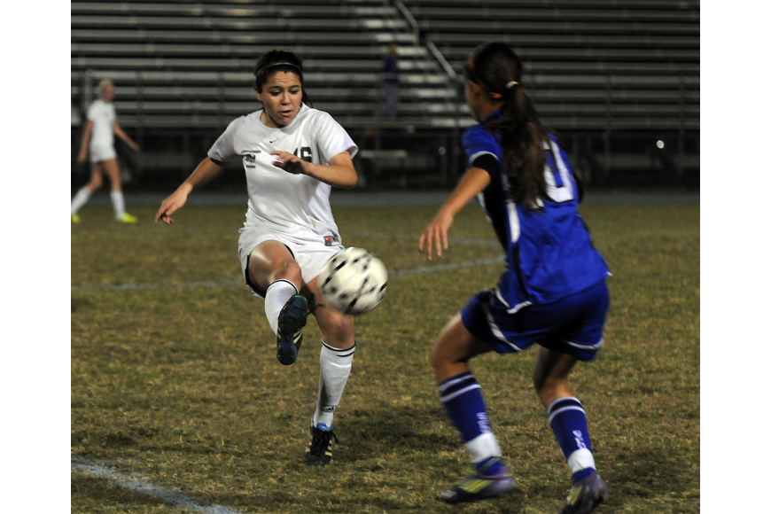 Lakewood Ranch midfielder Lindsay Martinez fights for passion in the first half.