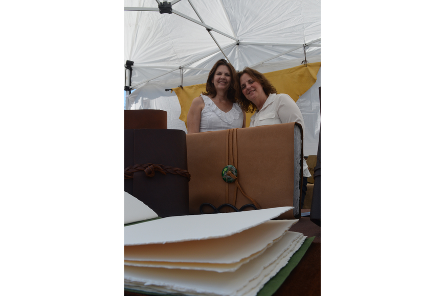 Pam McRee and Priscilla Elfrink make leather bound journals and books. They tear the paper by hand and sew the journals