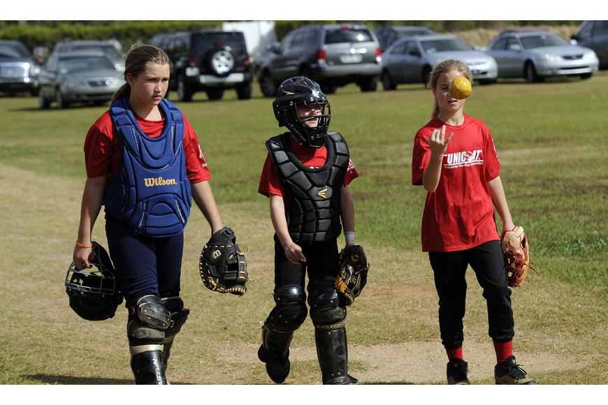 Mikayla Desantis, 10, Grace Hogie, 9, and Alissa Kessler, 9, all play for Unicoat in the 10U division.