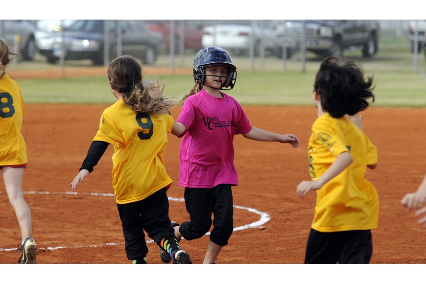 Vogel Construction's Kelsey Vogel, 8, congratulates Gator Air players on a good game.