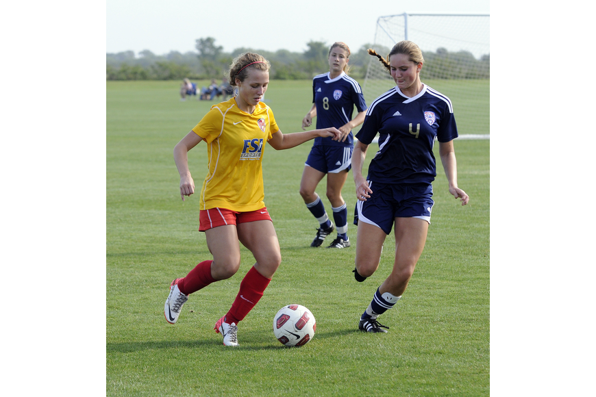 Clearwater Chargers Elite forward Kassidee Davis maneuvers the ball around a West Side Lady Eagles defender.