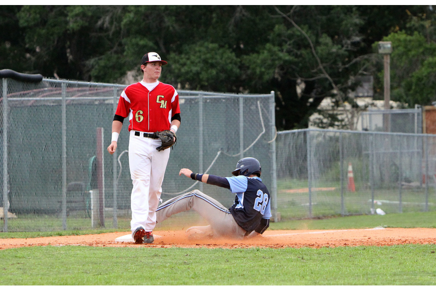 Out-of-Door Academy's Tyler Dietrich, No. 28, slides into third.