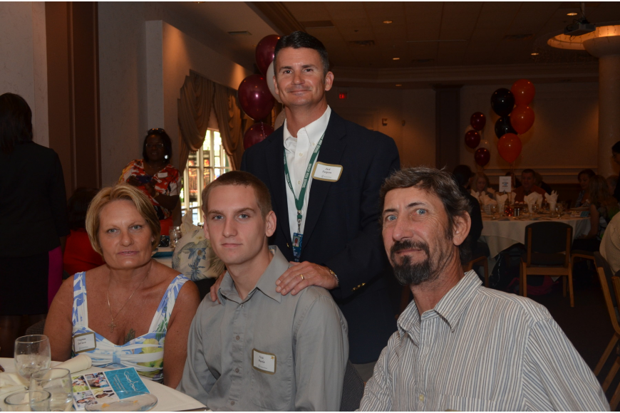 Venice High School student Nicholas Martin with his parents Gabrielle and Virginia DeCicco and Venice High School Principal Jack Turgeon