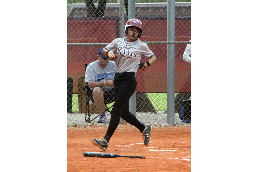 Riverview's Alissa Jackson, 13, crosses home plate.