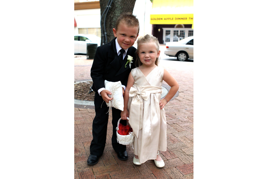 Charlie, 4, and Madelyn, 3, Forbes were the ring bearer and flower girl.