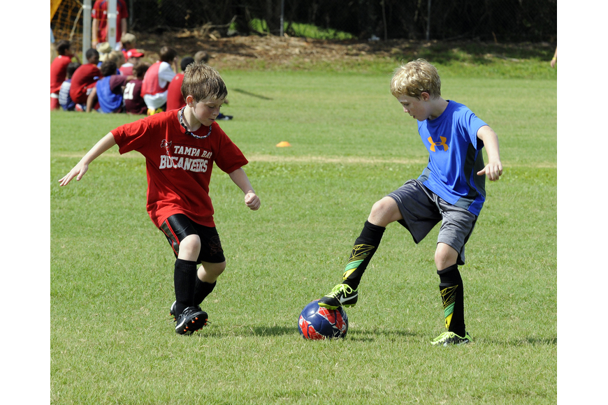 James Buttari, 8, and Jonah Hayden, 9, compete during a team wars competition.