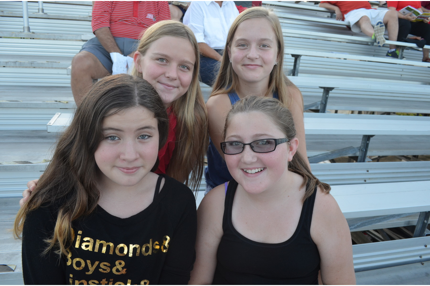 Isabella Atwood, 11, Emily McGregor, 11, and sisters Victoria Snyder, 12 and Amanda, 11, wait for the football game to begin.