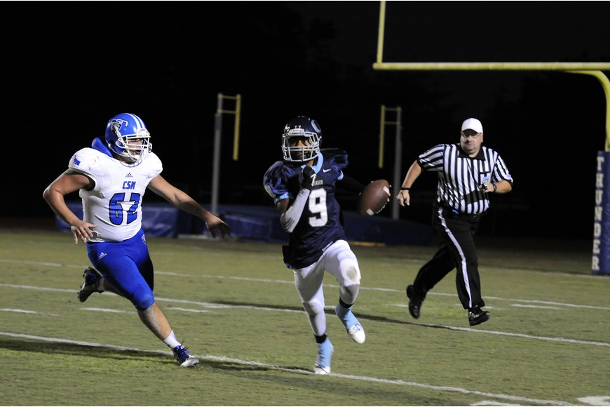 ODA quarterback David Grain scrambles for a first down in the second quarter.