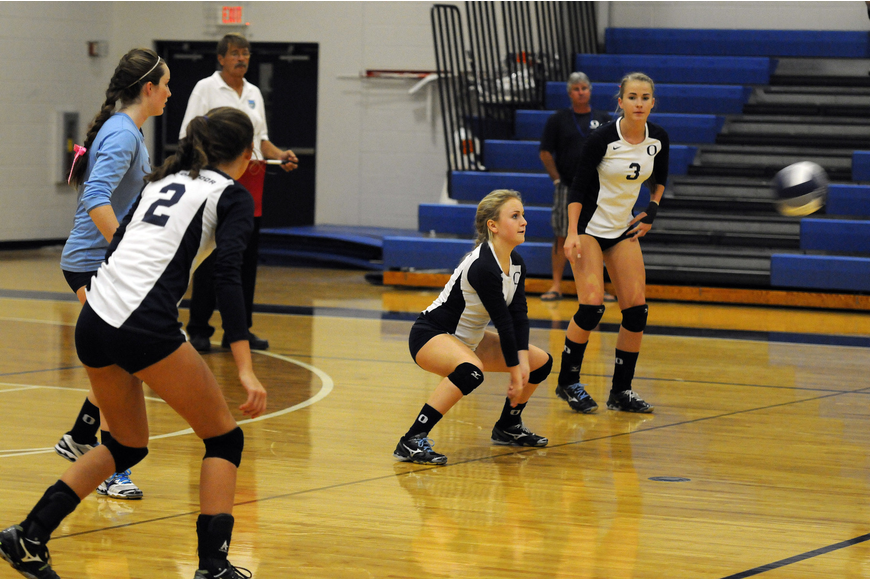 ODA freshman Greta Holland passes the ball back up to a teammate in the second set.