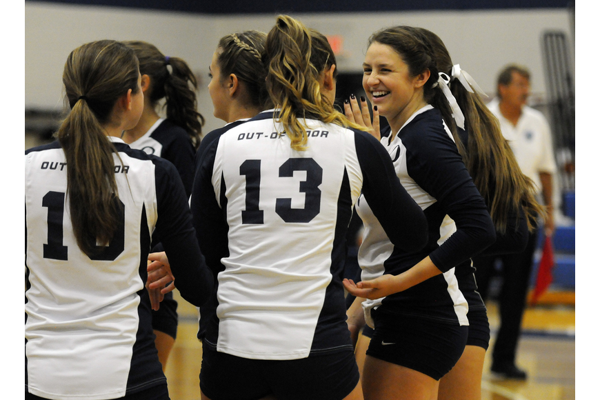 Taylor Albano is congratulated by her teammates following her go-ahead point late in the fourth set.