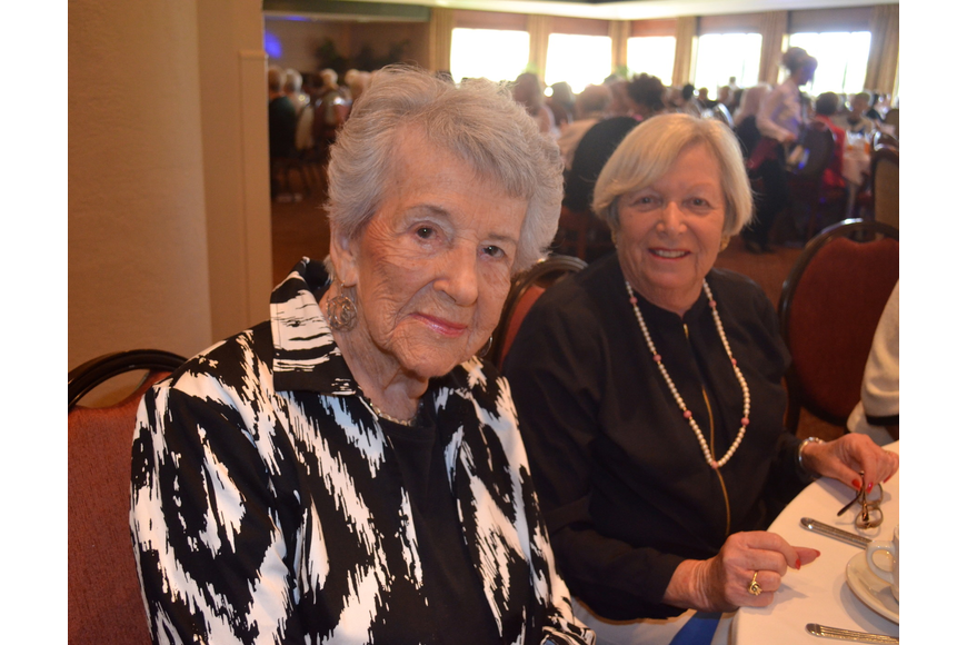 Marge Natell and Sandy Rotner prepare to eat lunch.