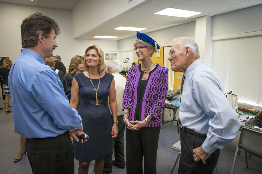 Dr. Michael Probstfeld (Dr. Carol F. Probstfeld's brother) and SCF President Dr. Carol F. Probstfeld, speak with Dr. Sarah H. Pappas, the college's fourth president, and Dr. Stephen Korcheck, the college's third president.
