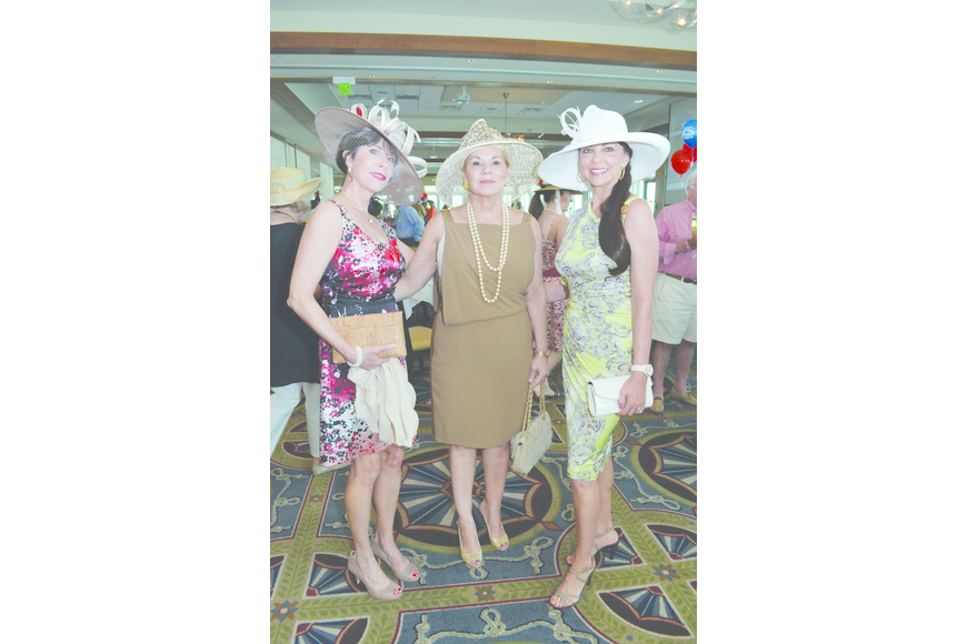 Kathleen Dillon, Brenda Ducray and Ronna Bridges top off Sarasota Yacht Club's Derby Day party May 4 with festive hats.
