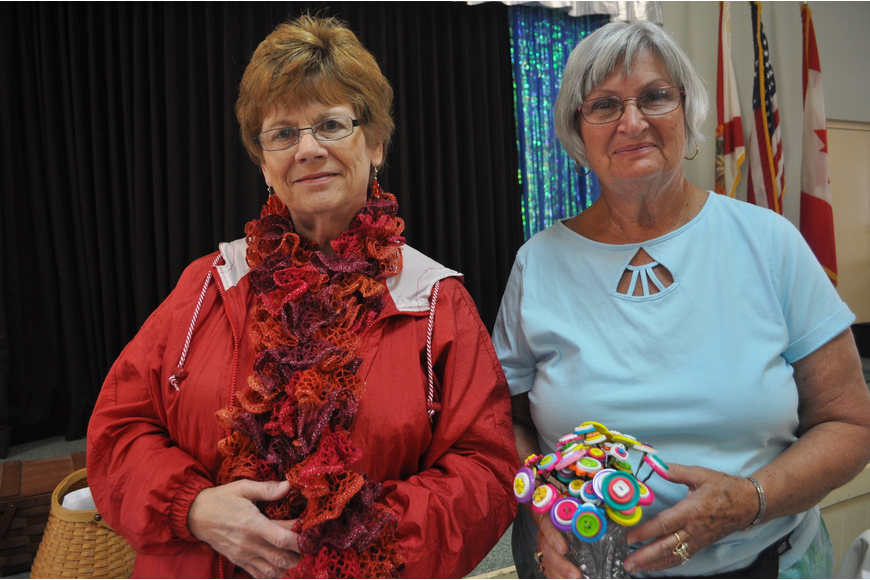 Diane Childs showed off her knitted scarves with Pat Allen, who crafted flowers out of buttons.